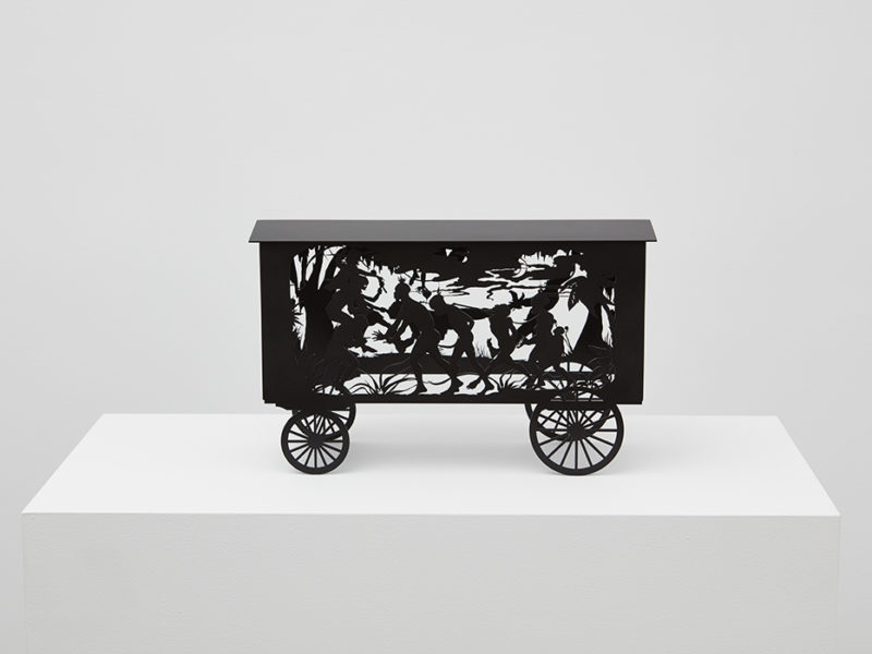 The Katastwóf Karavan (maquette), 2017, by Kara Walker; painted laser-cut stainless steel; 9 x 14 1/2 x 5 1/2 inches; Edition 30 of 30; Museum purchase; image courtesy of Sekkima Jenkins & Co.