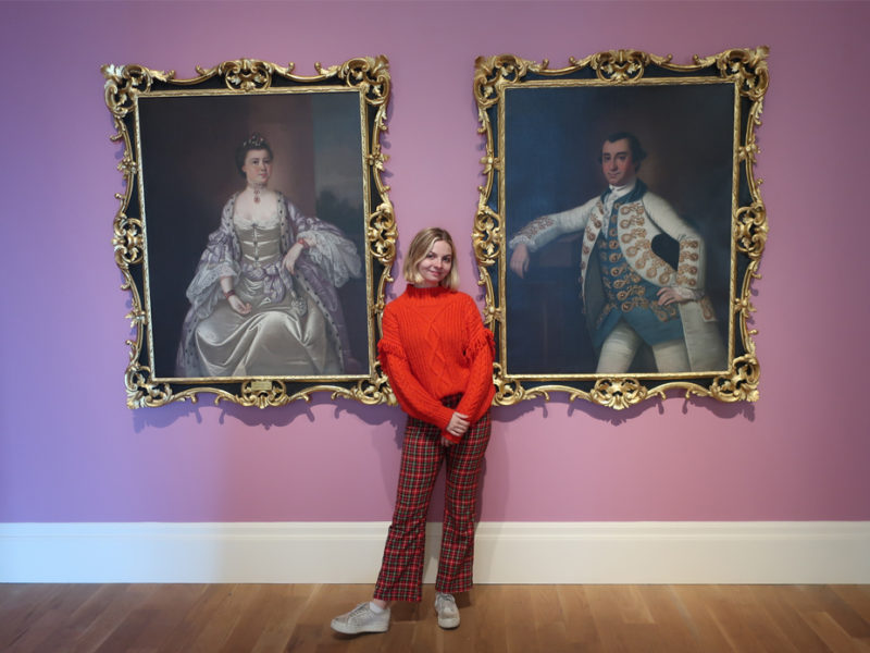 Gibbes Education Intern Brittany Marino poses in the main gallery. Brittany loves sharing her passion for the arts with the many students who visit the Museum on field trips.