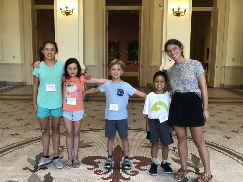 Education Intern Gabriela explores the galleries with Gibbes Summer Campers.