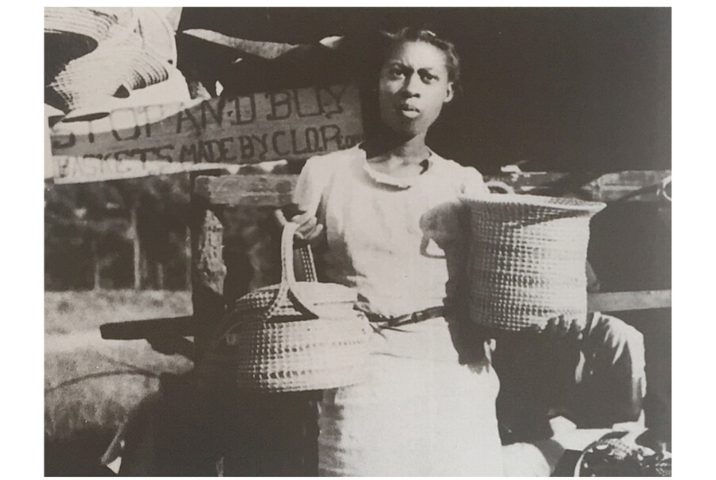 "Viola Jefferson, photographed in 1938 on Hamlin Rd. in Mt. Pleasant by Bluford Muir (active 1940s.) Courtesy of USDA Forest Service. Reproduced Dale Rosengarten, ""Babylon Is Falling: The State of the Art of Sweetgrass Basketry."" Southern Cultures 24, no. 2 (2018): 98-124."