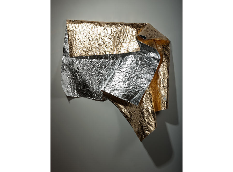 Damaged Emergency Blanked (for B. McQ.), 2015. Composition gold and aluminum leaf on distressed paper; 50 x 90 inches. Courtesy of the artist.