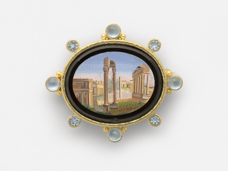 Roman Forum, Rome, 19th century; Micromosaic set in gold as a brooch, with alternating 6-mm cabochon aquamarines with side gold dots and 5-mm faceted aquamarines around bezel; 54 x 62 mm; Collection of Elizabeth Locke