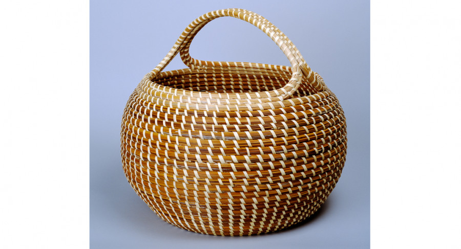 <i>Cobra with Handle</i>, ca. 1980, by Mary Jackson (American, b. 1945); sweetgrass, bulrush, palmetto, and pine needles; 15 x 16 inches; Museum purchase with funds donated by Mr. Robert Marks; 1984.026