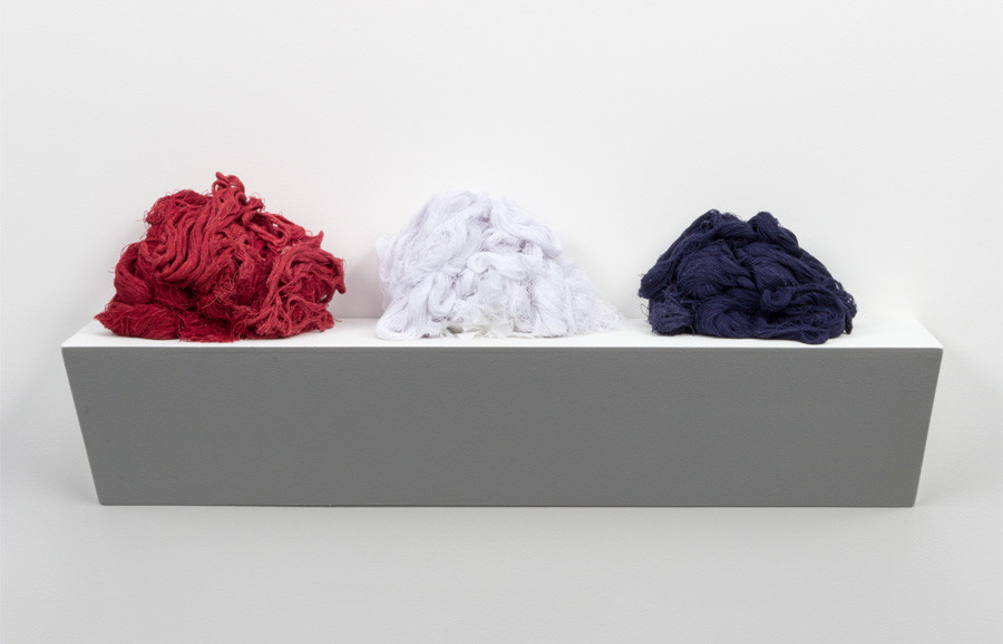<i>Unraveled</i>, 2015, by Sonya Clark (American, b. 1967); unraveled cotton Confederate battle flag; 11 x 36 x 7 inches; Courtesy of the artist